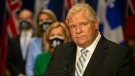 Ontario Premier Doug Ford, right, stands in front of a selection of his cabinet ministers during a joint press conference with Quebec Premier Francois Legault at the Ontario-Quebec Summit, in Toronto on Wednesday, September 9, 2020. THE CANADIAN PRESS/Chris Young