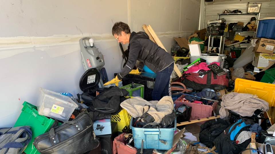 Julie Ramsay sifts through items that were stolen from her Moose Jaw storage locker. (Marc Smith/CTV News)