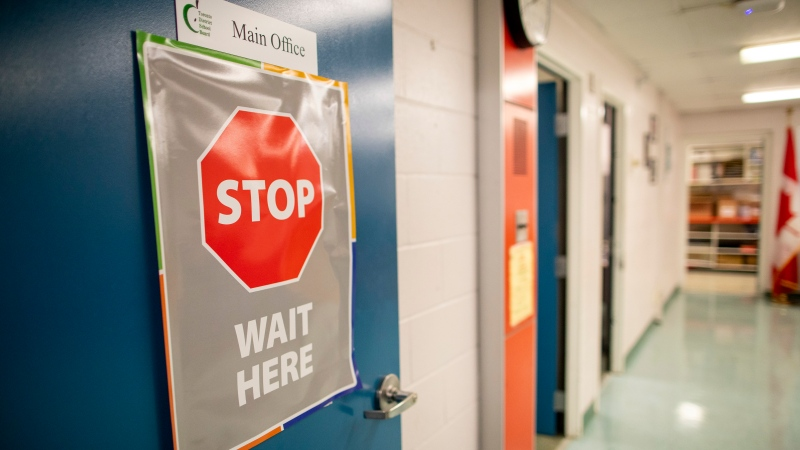 A sign outside the main office is seen at Kensington Community School amidst the COVID-19 pandemic on Tuesday, September 1, 2020. THE CANADIAN PRESS/Carlos Osorio