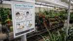 A sign from Alberta Health Services instructs people on good hygiene at Golden Acre Home and Garden centre in Calgary, Alta., Tuesday, April 14, 2020, amid a worldwide COVID-19 pandemic. THE CANADIAN PRESS/Jeff McIntosh