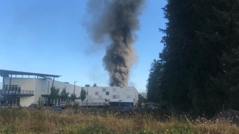 Firefighters are battling a fire at Schnitzer Steel near Nanaimo Thursday morning. (CTV News)
