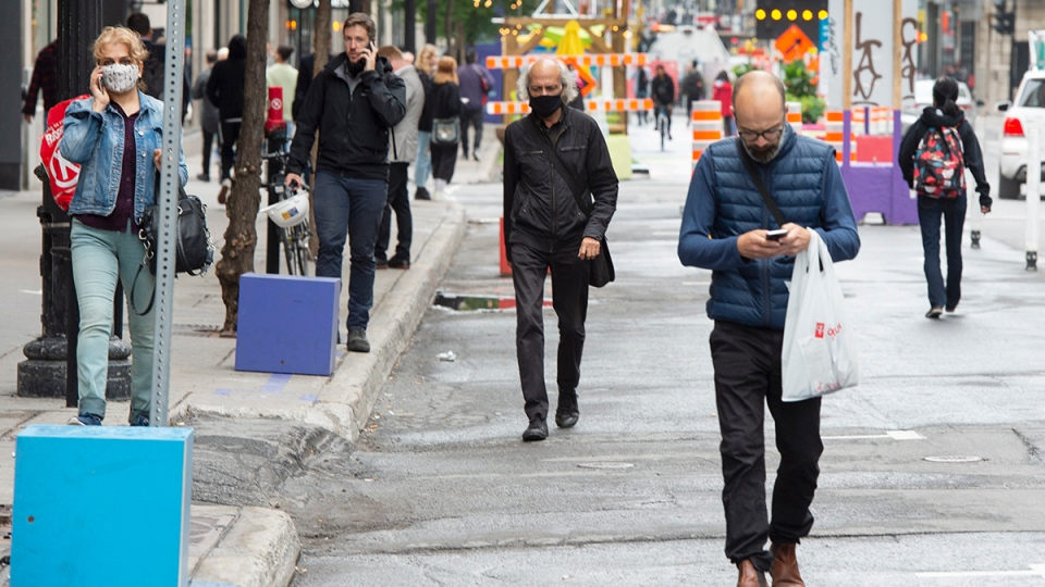 People walk down St.Catherine street Thursday, September 10, 2020 in Montreal. THE CANADIAN PRESS/Ryan Remiorz