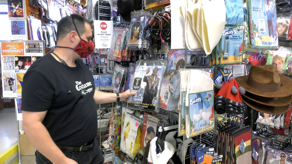 The Costume Shoppe owner Ryan Schoel looks over some inventory in his southeast store