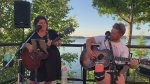 From a lakeside deck in Kapsuskasing, Jessie and Shelly cover 'Me and Bobby McGee.'