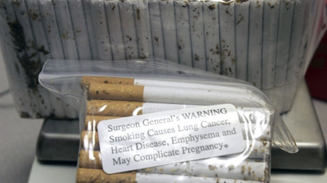 Confiscated cigarettes are shown at the Royal Canadian Mounted Police office in Cornwall, Ont., Wednesday, Nov. 14, 2007. (AP Photo/Mike Groll)