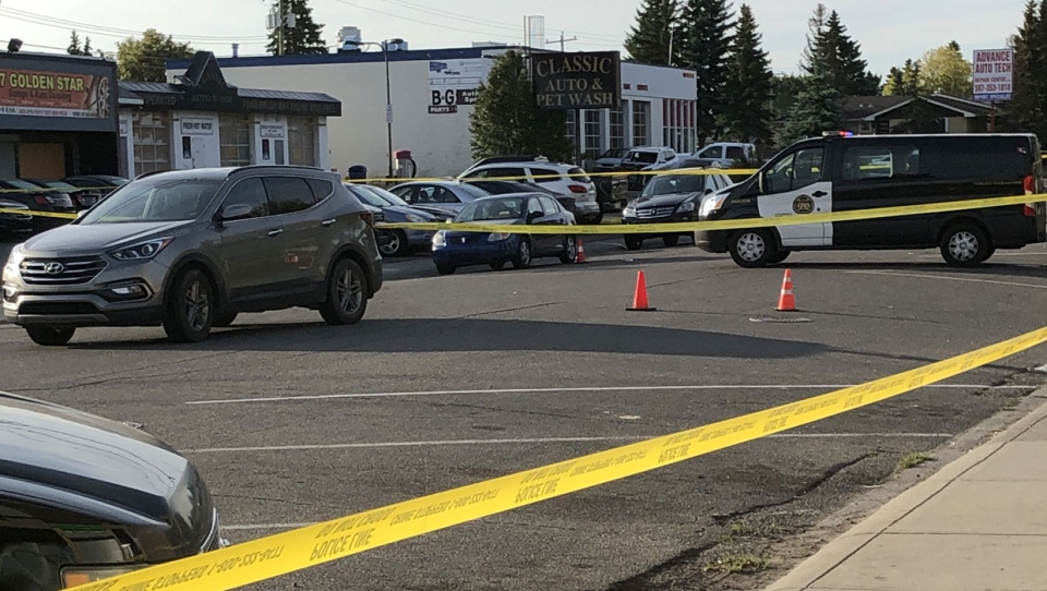 CPS members and crime scene tape outside of the Portico Hookah Lounge in southeast Calgary on Sept. 12, 2020 during the investigation into a fatal shooting