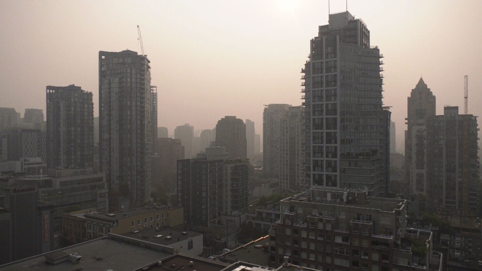 U.S. wildfire smoke creates a heavy blanket of smog over downtown Vancouver.