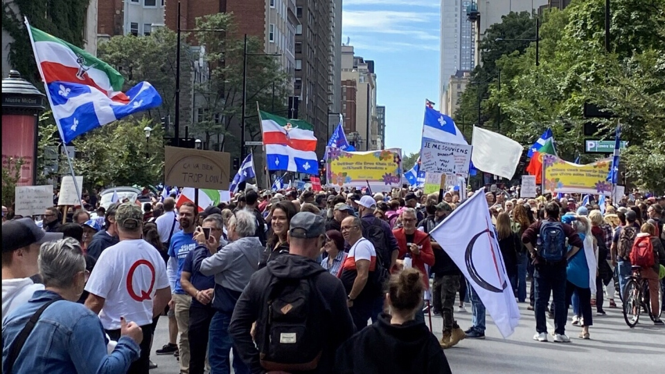 Thousands of people marched through downtown Montreal on Sat., Sept. 12, 2020 in opposition to Quebec's regulations requiring masks in in door public spaces.