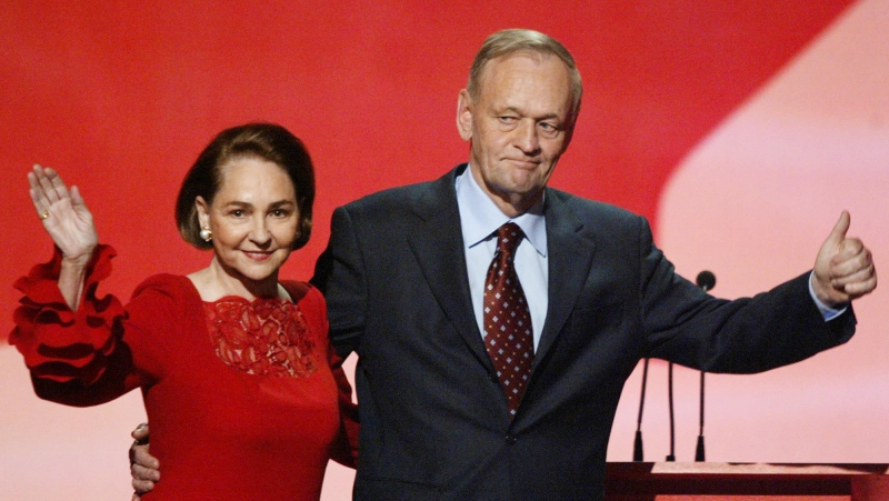 Prime Minister Jean Chretien gives a thumbs-up while his wife Aline waves to supporters following a tribute ceremony honouring the prime minister at the Liberal leadership convention in Toronto Thursday, Nov. 13, 2003.(CP PHOTO/Tom Hanson)