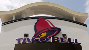 This Aug. 3, 2017, file photo shows a Taco Bell sign at a restaurant in Hialeah, Fla. (AP Photo/Alan Diaz, File)