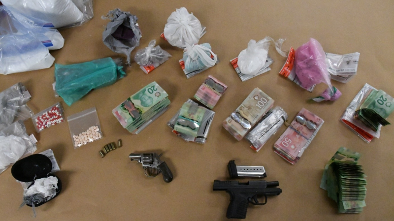 Drugs, cash and weapons seized on Friday, Sept. 11, 2020 are seen in this image released by the London Police Service.
