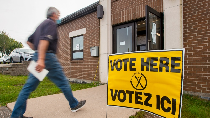 A resident arrives to vote in the New Brunswick provincial election at St. Mark's Catholic Church in Quispamsis, N.B. on Monday, Sept. 14, 2020. (THE CANADIAN PRESS/Andrew Vaughan)