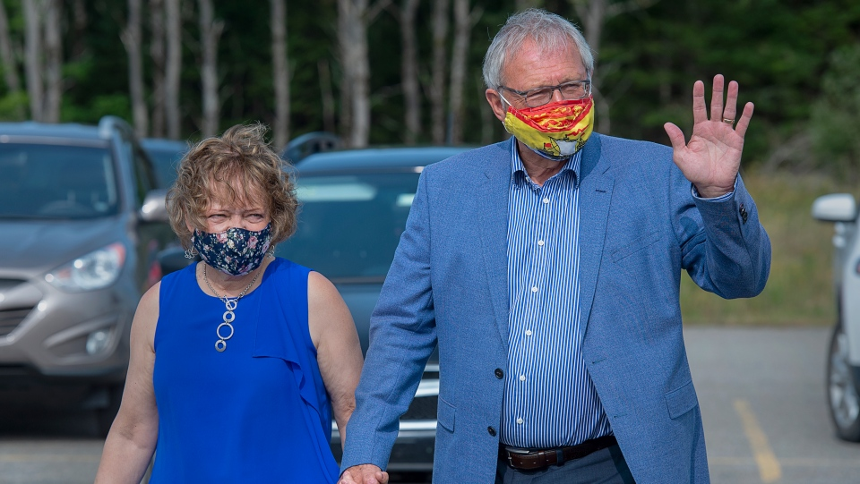 Premier Blaine Higgs arrives with his wife Marcia to vote in the New Brunswick provincial election in Quispamsis, N.B. on Monday, Sept. 14, 2020.  (THE CANADIAN PRESS/Andrew Vaughan)