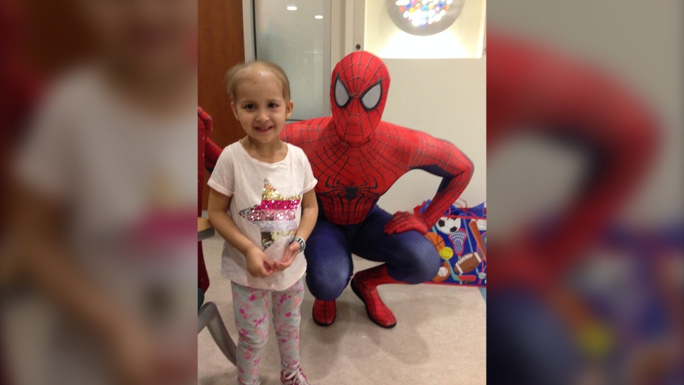 Izel Lopez-Daley meets Spiderman while staying at CHEO. (Photo provided by Rachelle Daley)