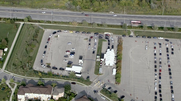 Dozens of cars are seen waiting at William Osler's drive-thru testing centre in Etobicoke Monday. (CTV News Toronto)
