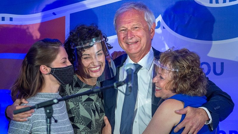 Premier Blaine Higgs embraces his wife Marcia Higgs, right, and daughters Rachel Hiltz, left and Lindsey Hiltz after winning the New Brunswick provincial election in Quispamsis, N.B. on Monday, Sept. 14, 2020.  (THE CANADIAN PRESS/Andrew Vaughan)