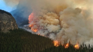 An out-of-control wildfire north of Banff National Park is shown in a government handout photo. Crews battling the wildfire are hopeful that cooler temperatures and wet forecast will make their jobs easier. THE CANADIAN PRESS/HO-Alberta Government