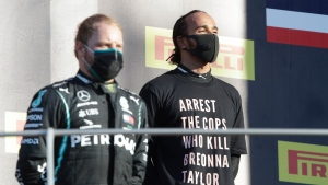 Mercedes driver Lewis Hamilton of Britain, right, is flanked by Mercedes driver Valtteri Bottas of Finland on the podium after winning the Formula One Grand Prix of Tuscany, at the Mugello circuit in Scarperia, Italy, Sunday, Sept. 13, 2020. (AP Photo/Luca Bruno, Pool)