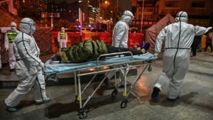 The first film to document the original outbreak of COVID-19 in Wuhan, China, premiered this week at the Toronto International Film Festival. (AFP)