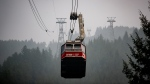 Heavy smoke and poor air quality in the Vancouver area have been caused by the wildfires burning south of the border.  <br><br> Smoke from wildfires burning in the U.S. fills the air as the Grouse Mountain tram transports people wearing face masks down the mountain, in North Vancouver, B.C,, on Saturday, Sept. 12, 2020. (Darryl Dyck / THE CANADIAN PRESS)