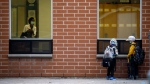 Children wait outside Elizabeth B. Phin Public School ahead of their first day of classes in Pickering, Ont., Tuesday, Sept. 8, 2020. (Photo: THE CANADIAN PRESS/Cole Burston)