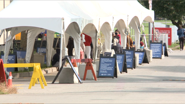 Residents line up outside the Brewer Arena in Ottawa to be tested for COVID-19, Sept. 14, 2020. (Chris Black / CTV News Ottawa)