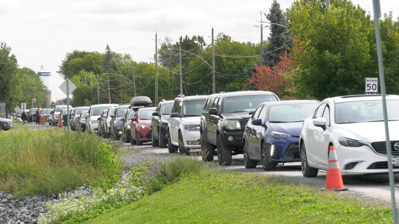 A row of cars lined up on Principale street waiting to get into the Casselman COVID-19 testing centre, Sept. 15, 2020 (Dave Charbonneau / CTV News Ottawa)