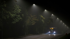 A bus drives through the smoky air in North Vancouver, Sunday, Sept. 13, 2020. THE CANADIAN PRESS/Jonathan Hayward