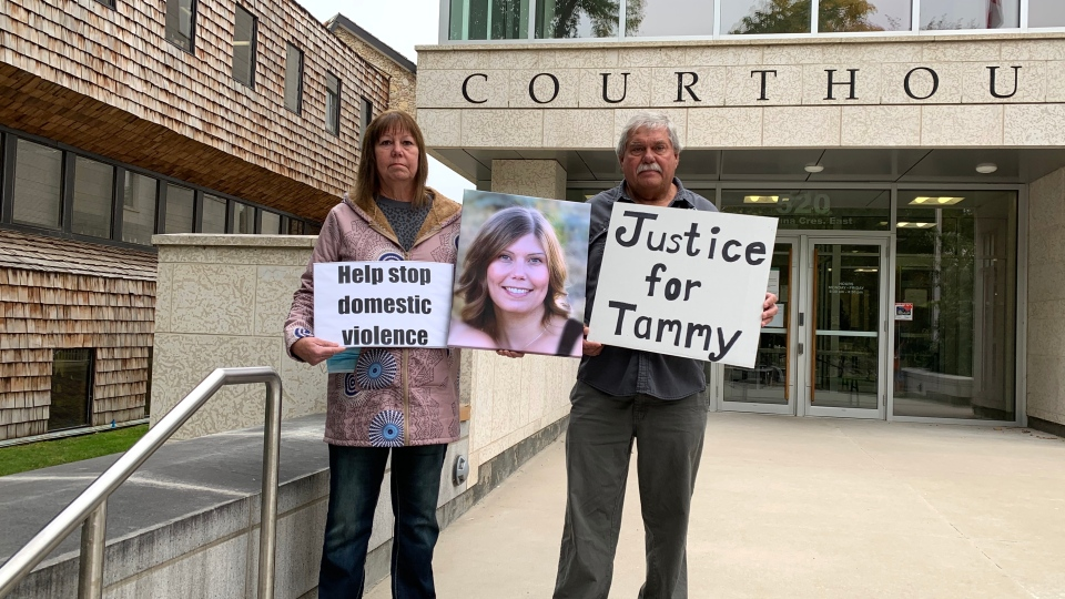 Gloria and Bruce Brown holding a picture of their late daughter, Tammy, outside Saskatoon's court of Queen's Bench. (Laura Woodward/CTV News)