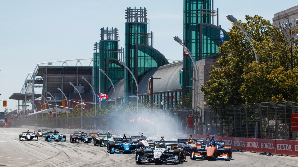 Simon Pagenaud of France leads the pack on his way to taking first place at the 2019 Honda Indy Toronto, in Toronto, Sunday, July 14, 2019. THE CANADIAN PRESS/Mark Blinch