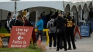 People line up outside a Covid testing facility in Ottawa, Tuesday, Sept. 15, 2020. (Adrian Wyld/THE CANADIAN PRESS)