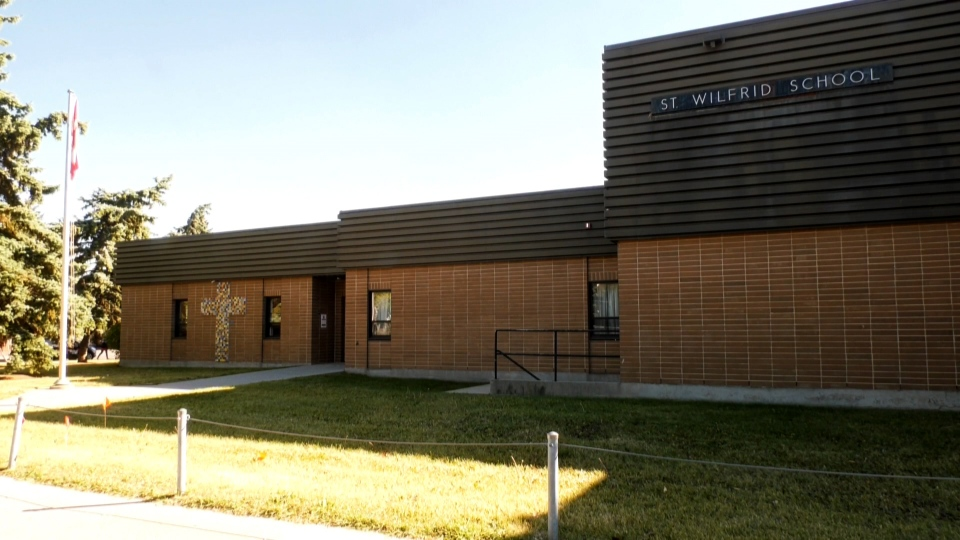 St. Wilfrid School in Calgary has been placed on watch status after six cases of COVID-19 were confirmed among students.
