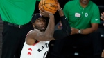Toronto Raptors' Terence Davis (0) shoots during the first half of an NBA basketball conference semifinal playoff game Sunday, Aug. 30, 2020, in Lake Buena Vista, Fla. (AP Photo/Ashley Landis)