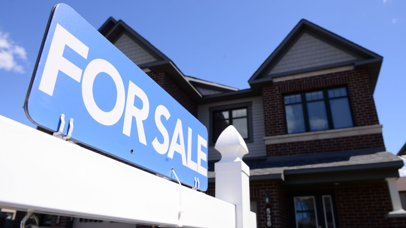 A new home is displayed for sale in a new housing development in Ottawa on Tuesday, July 14, 2020. THE CANADIAN PRESS/Sean Kilpatrick