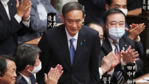 Yoshihide Suga is applauded after being elected as Japan's new prime minister at parliament's lower house in Tokyo, Wednesday, Sept. 16, 2020. (AP Photo/Koji Sasahara)