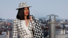 In this Tuesday, Oct. 1, 2019 file photo, Singer Cardi B poses for photographers as she arrives for the Chanel Ready To Wear Spring-Summer 2020 collection in Paris, France. (AP Photo/Francois Mori, file)