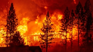 Climate change has been proven to amplify droughts that dry out regions, creating ideal conditions for wildfires to spread out-of-control. (AFP)