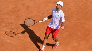 Serbia's Novak Djokovic reacts during his match against Italy's Salvatore Caruso, at the Italian Open tennis tournament in Rome, Wednesday, Sept. 16, 2020. (Alfredo Falcone/LaPresse via AP)