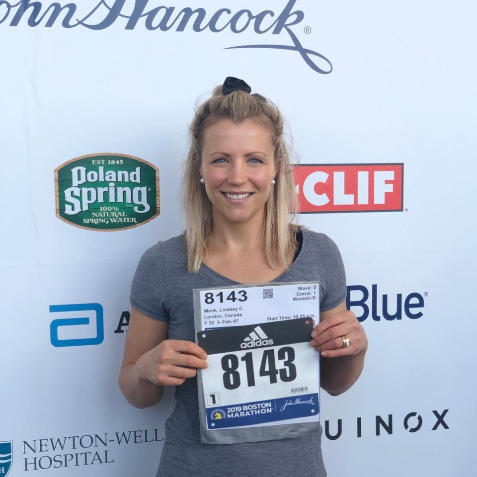 Lindsay Monk, seen holding Boston Marathon runners number in 2019.