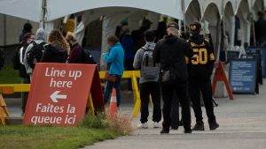 People line up outside a COVID testing facility in Ottawa, Tuesday, Sept. 15, 2020. THE CANADIAN PRESS/Adrian Wyld