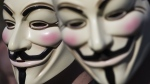 Two people are seen wearing Guy Fawkes masks in this stock image from Shutterstock.