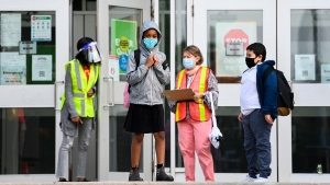 Children wait to enter at Portage Trail Community School which is part of the Toronto District School Board (TDSB) during the COVID-19 pandemic in Toronto on Tuesday, September 15, 2020. THE CANADIAN PRESS/Nathan Denette