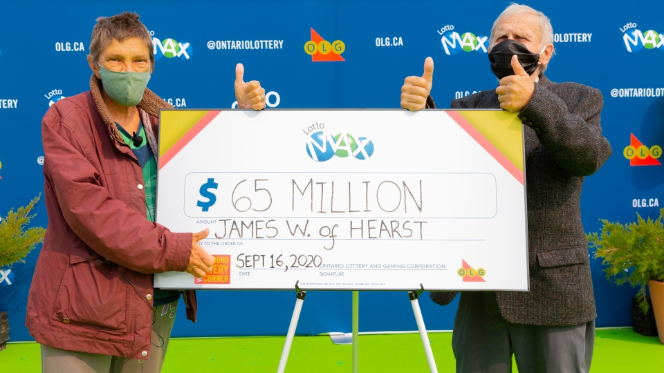 James Wickman (right) and his wife Eerikka (left) of Hearst drove to Toronto with family to collect a $65 million prize cheque. James won the jackpot from the Tuesday, September 8, 2020 LOTTO MAX draw.