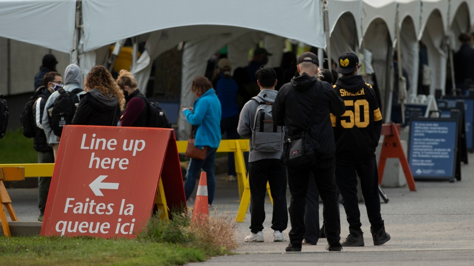 People line up outside a COVID-19 testing facility in Ottawa, Tuesday, Sept. 15, 2020. THE CANADIAN PRESS/Adrian Wyld