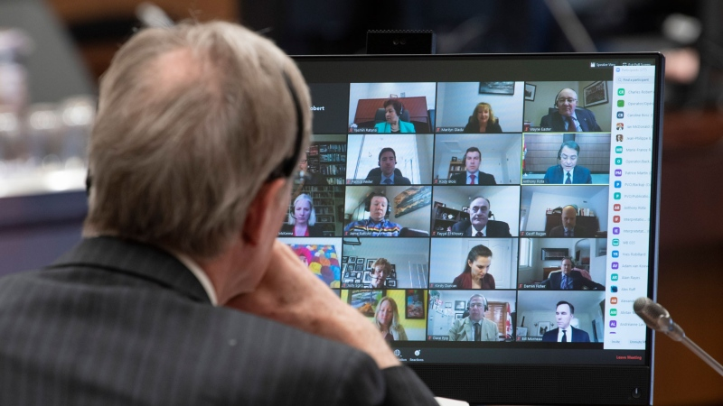 Canadian Members of Parliament are shown on a monitor during a virtual session of the House of Commons Tuesday April 28, 2020 in Ottawa. THE CANADIAN PRESS/Adrian Wyld