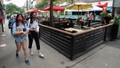 A handful of diners are seen on restaurant patios Tuesday, July 21, 2020 in Montreal. THE CANADIAN PRESS/Ryan Remiorz