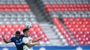 Montreal Impact forward Orji Okwonkwo (18) fights for control of the ball with Vancouver Whitecaps midfielder Michael Baldisimo (55) during second half MLS soccer action in Vancouver, B.C. Wednesday, September, 16, 2020. THE CANADIAN PRESS/Jonathan Hayward
