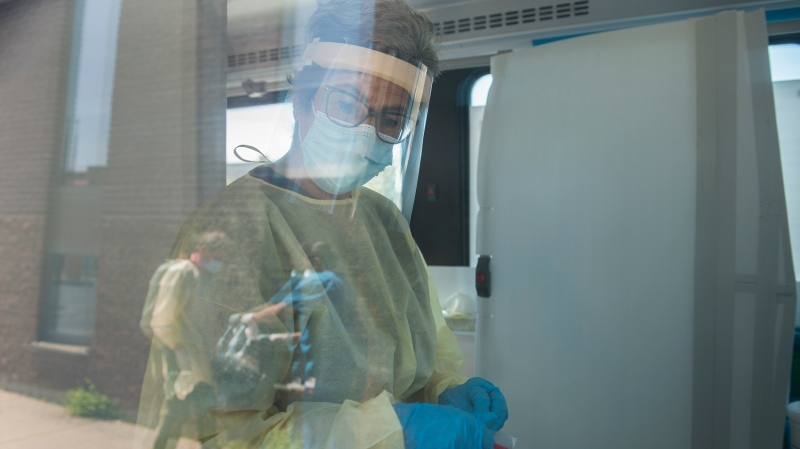 A health-care worker is shown inside a mobile COVID-19 test clinic, Monday, May 18, 2020, as the COVID-19 pandemic continues in Canada and around the world. THE CANADIAN PRESS/Graham Hughes