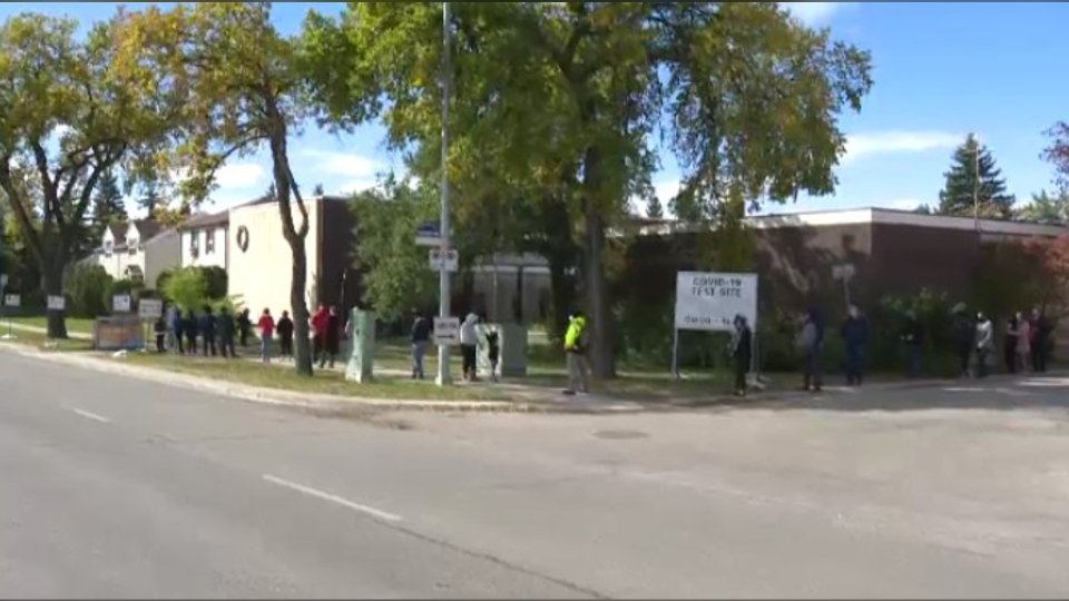 Dozens of people lined up outside a testing site in Winnipeg.