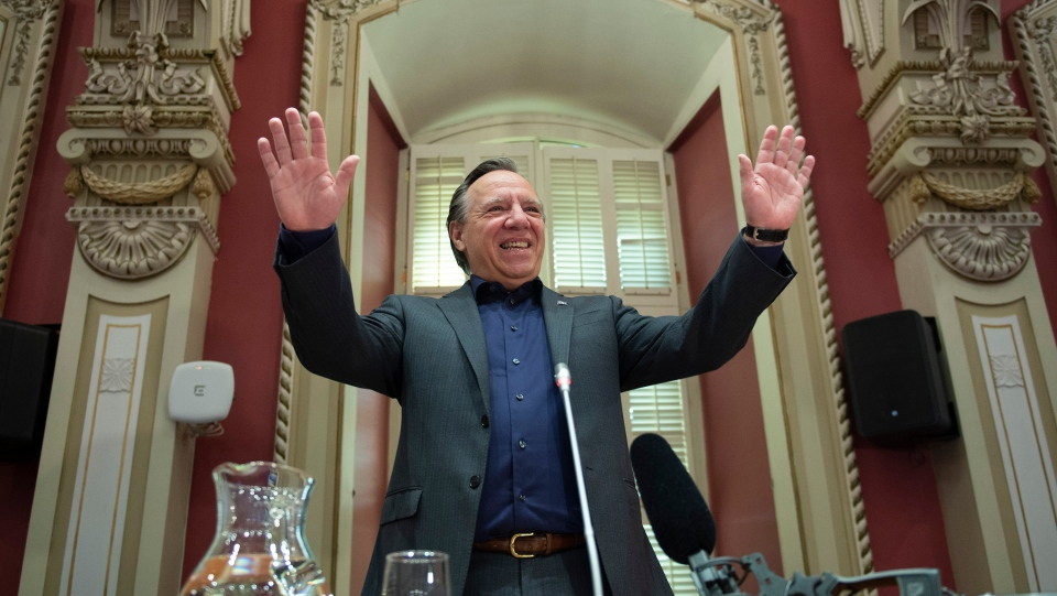 Quebec Premier Francois Legault waves to members of his caucus at a CAQ government pre-session caucus, Friday, September 11, 2020 at the Legislature in Quebec City. THE CANADIAN PRESS/Jacques Boissinot